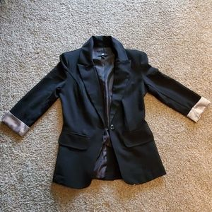 Blazer with pin stripped rolled sleeves.